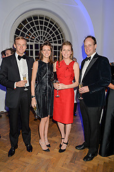 Left to right, JAMES & GENEVIEVE OSBORNE and GEORGE & ELEANOR OLVER at the Sugarplum Dinner in aid Sugarplum Children a charity supporting children with type 1 diabetes and raising funds for JDRF, the world's leading type 1 diabetes research charity held at One Marylebone, London on 18th November 2015.