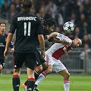 NLD/Amsterdam/20100928 - Champions Leaguewedstrijd Ajax - AC Milan, Demy de Zeeuw in duel met Gennaro Gattuso