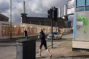 Battersea power station and exclusive housing in the Nine Elms development, south London. A woman jogger crosses the road and the street beyond is about to change before a new housing project starts. Homes alongside London's iconic Battersea power station have gone on sale, three years before the first one will be ready to move into. The Circus West development will see 800 homes built around the south London landmark, which is the largest brick building in Europe. The development includes a mixture of flats, townhouses and penthouses together with offices, shops and leisure facilities, and is the first phase of seven. By 2024 there will be more than 3,400 homes. Residents will have access to an elevated garden, and prices are similarly lofty: studio apartments start at £338,000, one-bed flats at £423,000.