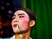 26 AUGUST 2018 - GEORGE TOWN, PENANG, MALAYSIA: A performer relaxes backstage before a Hokkien style Chinese opera on the Lim Jetty in George Town for the Hungry Ghost Festival. The opera troupe came to George Town from Fujian province in China. The Hungry Ghost Festival is a traditional Buddhist and Taoist festival held in Chinese communities throughout Asia. The Ghost Festival, also called Ghost Day, is on the 15th night of the seventh month (25 August in 2018). During the Hungry Ghost Festival, the deceased are believed to visit the living. In many Chinese communities, there are Chinese operas and puppet shows and elaborate banquets are staged to appease the ghosts.     PHOTO BY JACK KURTZ