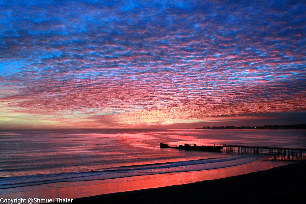 A colors of a brilliant sunset are reflected in the waters of Aptos Creek as it winds through Rio Del Mar Beach towards the Monterey Bay and over the Cement Ship and Seacliff State Beach.<br /> Photo by Shmuel Thaler <br /> shmuel_thaler@yahoo.com www.shmuelthaler.com