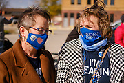 """16 OCTOBER 2020 - PERRY, IOWA: Women wearing Biden/Harris face masks wait to get into a """"Get Out the Vote"""" event with Doug Emhoff, the husband of Vice Presidential Candidate Kamala Harris. He spoke to a group of about 30 people. The crowd was socially distanced and masks were required in  keeping with CDC and state of Iowa health guidelines to deal with the COVID-19 pandemic. Emhoff is traveling throughout Nebraska and Iowa today, campaigning on behalf of the Biden/Harris ticket.          PHOTO BY JACK KURTZ"""