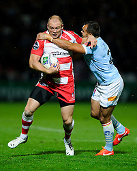Gloucester Outside Centre (#13) Mike Tindall is tackled by Perpignan replacement (#21) David Marty during the second half of the match - Photo mandatory by-line: Rogan Thomson/JMP - Tel: 07966 386802 - 12/10/2013 - SPORT - RUGBY UNION - Kingsholm Stadium, Gloucester - Gloucester Rugby v USA Perpignan - Heineken Cup Round 1.
