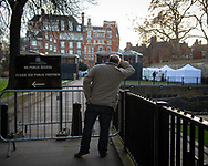 UK. London. The Village Green: From Blair to Brexit.<br /> A story on the relationship between the Media, Politicians and the public as they come together on College Green, a small patch of land next to The Houses of Parliament in Westminster. <br /> Photo shows a man next to a sign and gate that warns the public that they are excluded the from the Green during the BREXIT negotiations that followed the 2016 Referendum in which the UK voted to leave the EU.<br /> Photo©Steve Forrest/Workers' Photos