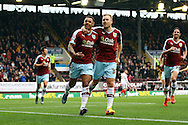 Andre Gray of Burnley (l) celebrates with his team mate Scott Arfield after scoring his teams 1st goal from the penalty spot. Skybet football league Championship match, Burnley v Huddersfield Town at Turf Moor in Burnley ,Lancs on Saturday 31st October 2015.<br /> pic by Chris Stading, Andrew Orchard sports photography.