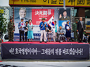09 JUNE 2018 - SEOUL, SOUTH KOREA: Speakers on stage during a pro-American rally in downtown Seoul. Participants said they wanted to thank the US for supporting South Korea and they hope the US will continue to support South Korea. Many were also opposed to ongoing negotiations with North Korea because they don't think Kim Jong-un can be trusted to denuclearize or to not attack South Korea.    PHOTO BY JACK KURTZ