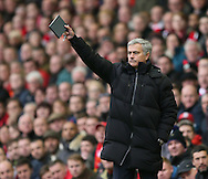 Jose Mourinho manager of Chelsea with his note book  - Barclays Premier League - Liverpool vs Chelsea - Anfield Stadium - Liverpool - England - 8th November 2014  - Picture Simon Bellis/Sportimage