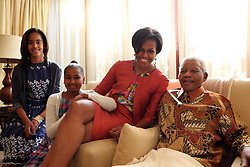 US First Lady Michelle Obama and her daughters Sasha and Malia pose with former South African President Nelson Mandela as they view his newest book titled 'Nelson Mandela by himself' at his home in Houghton, Johannesburg, South Africa on June 21, 2011. Michelle Obama is on her first solo trip to Africa with her two daughters Sacha and Malia. Photo by Nelson Mandela Foundation/ABACAPRESS.COM  Mandela Nelson Madiba Obama Malia Obama Malia Ann Obama Michelle Obama Sasha Deplacement Childs Children Kids Kid Enfants Enfant Child Fille Filles Daughter News Politique Politics South Africa SYdafrika Afrique du Sud  | 280141_001 Johannesburg Afrique du Sud South Africa