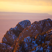 The majestic rock formations of the western Sandia rock faces - Majestic peaks rising from the desert floor shine on a winter's day at the golden time of day