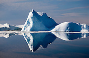 Pyramid iceberg reflected in the waters of Kane Basin, north east Greenland