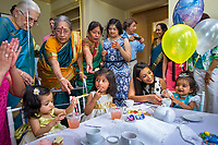 Houston, Texas | 2014<br /> Hema Ramaswamy (center) attends the celebration of her niece Rukmini's (far right) first birthday—a princess-themed tea party with four generations of family from Texas, New Jersey, and India.
