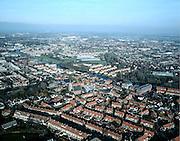 Nederland, Zuid-Holland, Valkenburg, 01-12-2005; luchtfoto (25% toeslag); dorpskern met eengezinswoningen gegroepeerd rond de kerk; aan de andere kant van de rivier de Oude Rijn, het (voormalig) kassengebied van Rijnsburg, nu nieuwbouwwijk met onder andere stadsvilla's; glastuinbouw, planologie, verstedelijking, milieu, ruimtelijke ordening, landschap; zie ook andere luchtfoto's van deze regio;.foto Siebe Swart