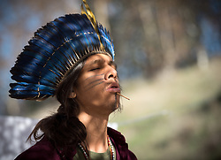 7 December 2019, Madrid, Spain: Tupá Mirim Joyan, a Guaraní man from Sao Paulo sings a traditional chant, bringing testimony of his indigenous roots and culture, as people of faith gather in a 'Prayer for the Rainforest' as part of the Cumbre Social por el Clima, on the fringes of COP25 in Madrid, where faith-based organizations continue to urge decision-makers to take action for climate justice.