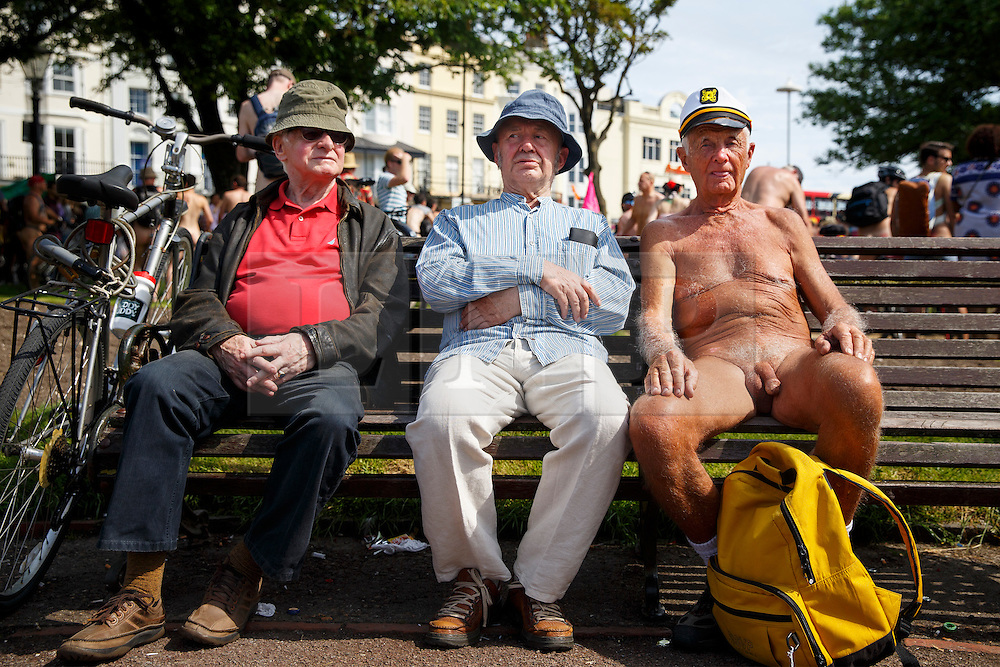 © Licensed to London News Pictures. 08/06/2014. BRIGHTON, UK. A nude protesters sitting on a bench with members of public at the Old Steine Gardens in Brighton on Sunday 8 June 2014 as part of the World Naked Bike Ride, which aims to raise awareness of cyclists on the roads and in the traffic. Photo credit : Tolga Akmen/LNP