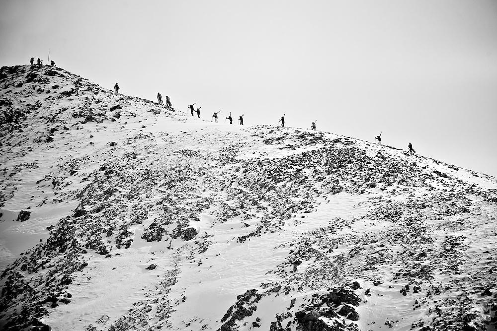 Skiers climb the East Wall at Arapahoe Basin Resort, CO. ©Brett Wilhelm