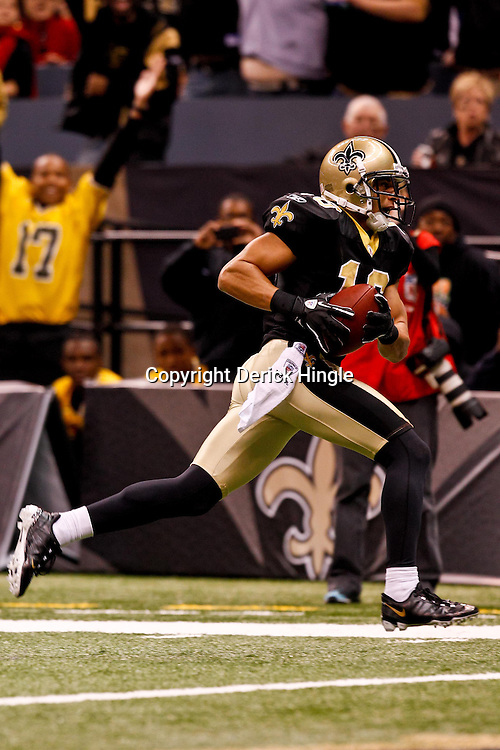 December 12, 2010; New Orleans, LA, USA; New Orleans Saints wide receiver Lance Moore (16) catches a touchdown against the St. Louis Rams during the third quarter at the Louisiana Superdome. Mandatory Credit: Derick E. Hingle-US PRESSWIRE