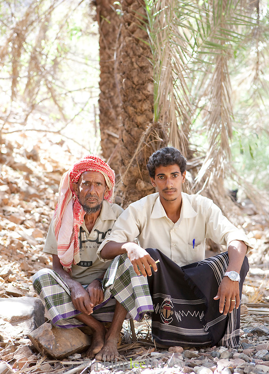 Father and Son sitting under a tree at in the Dixsam region, Socotra, Yemen