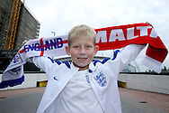 a young England fanholds up his scarf outside Wembley Stadium before k/o. FIFA World cup qualifying match, european group F, England v Malta at Wembley Stadium in London on Saturday 8th October 2016.<br /> pic by John Patrick Fletcher, Andrew Orchard sports photography.