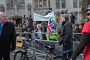 REMAIN SUPPORTERS ON LEFT, LEAVE ON RIGHT. BOTH HAVING A BREAK BEHIND THE BARRIER IN THE PRESS AREA.  , Outside the Supreme court of the United Kingdom, Parliament Sq. London. 5 December 2016.<br /> Beginning of four days of hearings on Brexit - and who has the power to trigger it. 11 justices listen to arguments on whether government or Parliament has that power.
