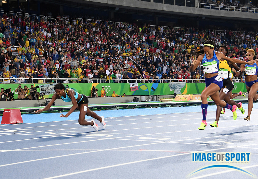 Aug 15, 2016; Rio de Janeiro, Brazil; Shaunae Miller (BAH) dives across the finish line to defeat Allyson Felix (USA) in the women's 400m, 49.44 to 49.51, at Estadio Olimpico Joao Havelange in the Rio 2016 Summer Olympic Games.