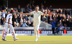 England's James Anderson celebrates after bowling West Indies' Kraigg Brathwaite to take his 500th Test wicket during day two of the Third Investec Test match at Lord's, London.
