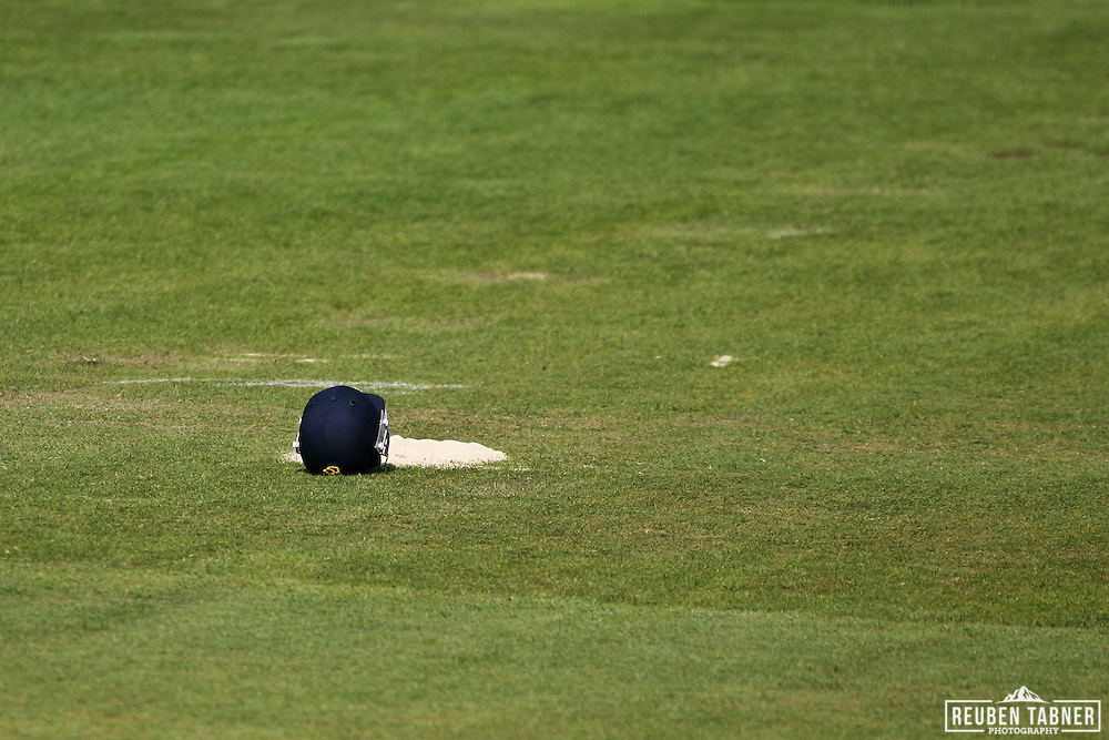 © Reuben Tabner. .Emirates Durham ICG, Durham, UK  23/04/11. LV= County Championship - Durham ccc v Sussex CCC. A helmet sits next to a pile of sawdust during play.