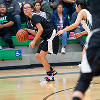 In Newcomb, Kallie Truijillo (32) of Tse Yi Gai dribbles near the sideline as the final seconds of the fourth quarter wined down, Hannah Begay (0) of Newcomb defends the three point shot. Tse Yi Gai won 57-48 on Saturday.