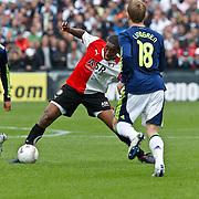 NLD/Rotterdam/20100919 - Voetbalwedstrijd Feyenoord - Ajax 2010, Leroy Fer in duel met Rasmus Lindgren