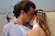 Romantic couple walks on the beach