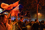 French nationals celebrate at the Champs-Élysées, as France beats Croatia in the World Cup Final. Paris, France.