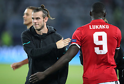 Real Madrid's Gareth Bale (left) pats Manchester United's Romelu Lukaku on the back before the UEFA Super Cup match at the Philip II Arena, Skopje, Macedonia.