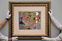 June 15, 2017 - London, UK - London, UK. Technicians hang ''Femme et oiseaux'', 1940, by Joan Miró (estimate on request).  Preview of Impressionist and Modern art sale, which will take place at Sotheby's New Bond Street on 21 June. (Credit Image: © Stephen Chung/London News Pictures via ZUMA Wire)