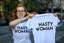 "© Licensed to London News Pictures. 08/11/2016. New York CIty, USA. A Democrat supporter sells ""Nasty Woman"" t-shirts in Union Square, New York City on Tuesday, 8 November, the day of the presidential election in the United States of America. Photo credit: Tolga Akmen/LNP"