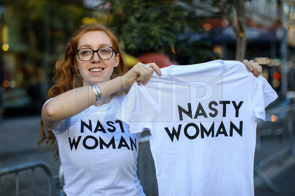 """© Licensed to London News Pictures. 08/11/2016. New York CIty, USA. A Democrat supporter sells """"Nasty Woman"""" t-shirts in Union Square, New York City on Tuesday, 8 November, the day of the presidential election in the United States of America. Photo credit: Tolga Akmen/LNP"""