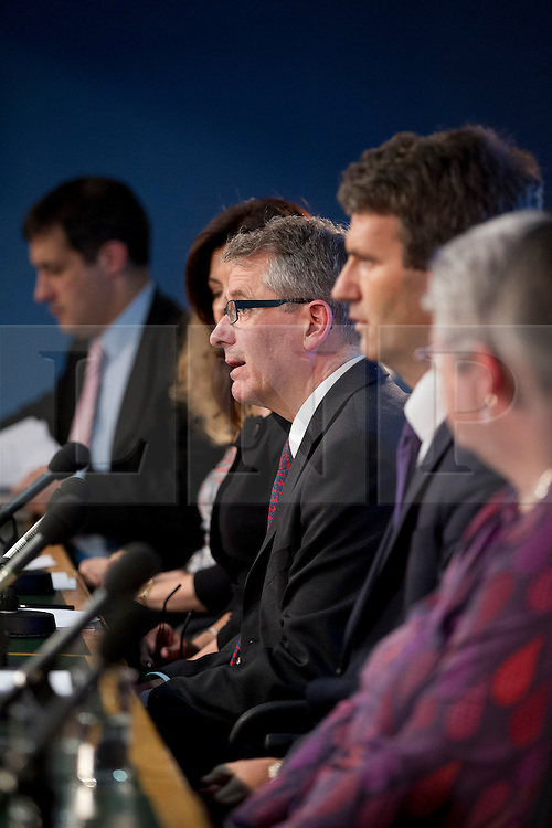 © Licensed to London News Pictures. 29/11/2012. London, UK. Professor Brian Cathcart, director of 'Hacked Off' (centre, glasses) is seen talking at a press conference in London today (29/11/12). The conference was called by the group as a reaction to the Leveson Inquiry which was published today. Photo credit: Matt Cetti-Roberts/LNP
