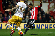Florian Jozefzoon of Brentford (r) scores his team's second goal. EFL Skybet football league championship match, Brentford v Sheffield Wednesday at Griffin Park in London on Saturday 30th December 2017.<br /> pic by Steffan Bowen, Andrew Orchard sports photography.