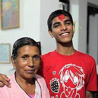 Asia, Nepal, Kathmandu. A Nepali grandmother and grandson.
