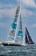 The french yacht Safran and the biggest monohull in the fleet, Comanche (right) pass at the start of the 90th anniversary Rolex Fastnet Race on the Solent. A record fleet of 370 yachts will compete to win the Fastnet Challenge Cup.<br /> The 600 nautical mile race starts in Cowes, Isle of Wight, heading to the Fastnet Rock off the south west coast of Ireland and finishes in Plymouth.<br /> It is the world's biggest offshore race with 75% amateur sailors and professional yachtsmen competing against each other. <br /> Picture date Sunday 16th August, 2015.<br /> Picture by Christopher Ison. Contact +447544 044177 chris@christopherison.com