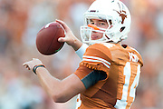 AUSTIN, TX - AUGUST 31: David Ash #14 of the Texas Longhorns warms up before kickoff against the New Mexico State Aggies on August 31, 2013 at Darrell K Royal-Texas Memorial Stadium in Austin, Texas.  (Photo by Cooper Neill/Getty Images) *** Local Caption *** David Ash