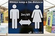 Social Distancing 2 metres apart information notice sign in Lowden garden centre shop, Wiltshire, England, UK, May 2020