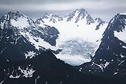 Glacier surrounded by snow covered mountain peaks, Skjervøy municipality, Norway Ⓒ Davis Ulands | davisulands.com