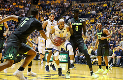 Jan 9, 2018; Morgantown, WV, USA; West Virginia Mountaineers guard Jevon Carter (2) drives down the baseline during the second half against the Baylor Bears at WVU Coliseum. Mandatory Credit: Ben Queen-USA TODAY Sports