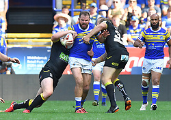 Leeds Rhinos' Adam Cuthbertson is tackled during the Ladbrokes Challenge Cup Semi Final match at the Macron Stadium, Bolton.