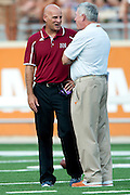 AUSTIN, TX - AUGUST 31: Head coach Doug Martin of the New Mexico State Aggies speaks with head coach Mack Brown the Texas Longhorns before kickoff on August 31, 2013 at Darrell K Royal-Texas Memorial Stadium in Austin, Texas.  (Photo by Cooper Neill/Getty Images) *** Local Caption *** Doug Martin; Mack Brown