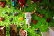 """SHOT 2/5/18 10:36:47 AM - A painted cow skull and hearts for sale at Esto Es Mexico in Sayulita, Mexico. Sayulita is a village about 40 km (25 miles) north of downtown Puerto Vallarta in the state of Nayarit, Mexico, with a population of approximately 5,000. Known for its consistent rivermouth surf break, Sayulita was """"discovered"""" by roving surfers in the late 1960s with the construction of Mexican Highway 200. Still a mecca for beginning surfers of all ages, Sayulita also attracts tourists to its numerous art galleries and casual and hipsters cafes and restaurants. (Photo by Marc Piscotty / © 2018)"""