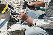 Close-up of a Stonemason at work. Photographed in Greece