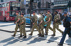 © Licensed to London News Pictures. 25/05/2017. London, UK. Armed soldiers and police walk past Victoria Station in Westminster, London following a terrorist attack in Manchester, northern England, earlier this week. 23 people were killed an dozens more injured when Salman Abedi set off a suicide bomb at an Ariana Grande concert.  Photo credit: Ben Cawthra/LNP