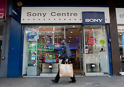 © licensed to London News Pictures. London, UK 12/04/2012. A man walking past a Sony Centre in Wood Green. Sony was reported to be looking to shed 10,000 jobs worldwide this year as the company losses £4.2bn this year. Photo credit: Tolga Akmen/LNP