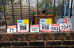 © Licensed to London News Pictures. 11/04/2020. Stoneleigh, UK. Kevin Webber's Marathon des Sables ultramarathon race ID numbers are displayed in his Surrey garden during lockdown. Kevin has run the entire 230Km (143 miles) 6 stage race in his small back and front gardens, completing 2734 laps, over 6 days - finishing today. Kevin, who was diagnosed with terminal prostate cancer just over 5 years ago was due to take part in his 5th consecutive running of what is described as the 'toughest foot race on Earth' through the Sahara Desert in Southern Morocco this month, but the 2020 six day race has been postponed until September.  Kevin is raising funds for the National Emergencies Trust Coronavirus Appeal who will distribute the funds to where they are needed most in the UK and he will jointly split what he raises with Prostate Cancer UK. Photo credit: Peter Macdiarmid/LNP