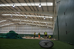 A discarded rugby ball and nets as workers lay flooring during the construction of a field hospital, which will hold up to 340 beds for coronavirus patients, at Llandarcy Academy of Sport, Neath, as the health services in the Swansea Bay area prepare their response to the coronavirus outbreak.